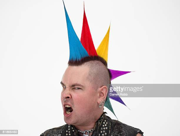 Male Punk Rocker with multi coloured spiked hair, screaming