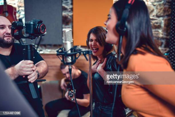 male recording band's new video in studio - musical equipment stock pictures, royalty-free photos & images