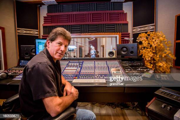 male recording engineer and artist in studio - dubbing stock photos and pictures