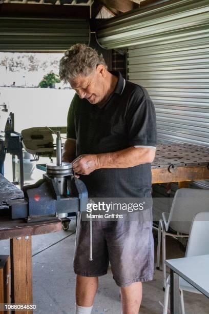 Male Retiree working on a metal woking tool