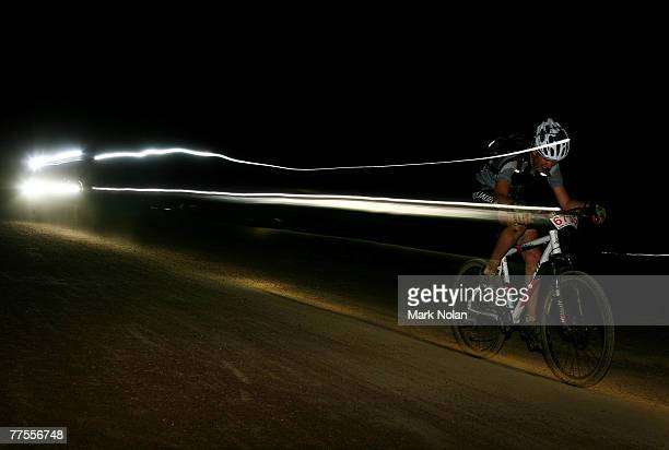 A male rider competes through the night during the Mont 24 Hour MTB Race held at Majura Pines forest on October 27 2007 in Canberra Australia All...