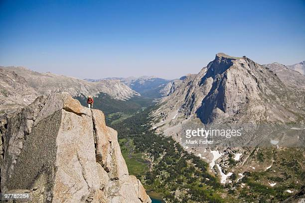 a male rock climber ascends the 50's classic route, the northeast face of pingora in the cirque of t - classic rock stock pictures, royalty-free photos & images