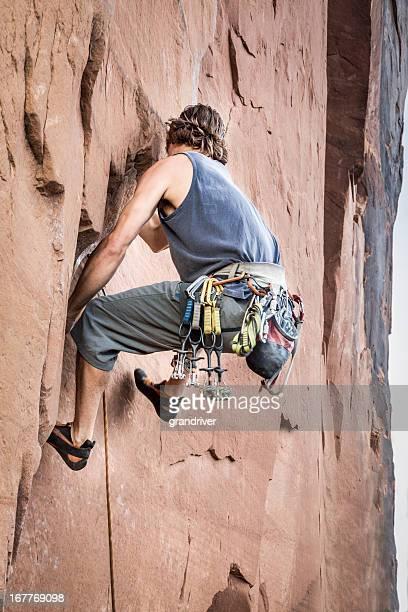 Male Rock Climber In Moab Utah