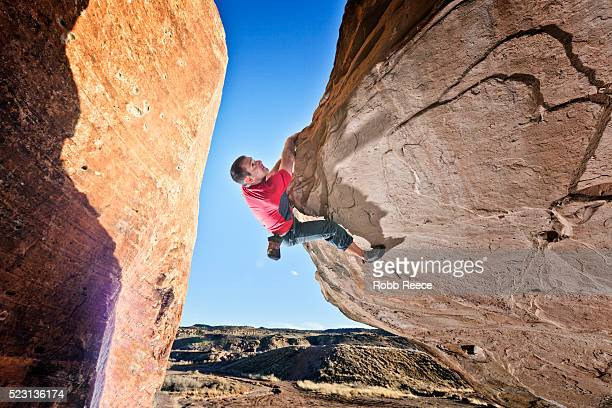 a male rock climber on a sandstone boulder - robb reece stock-fotos und bilder