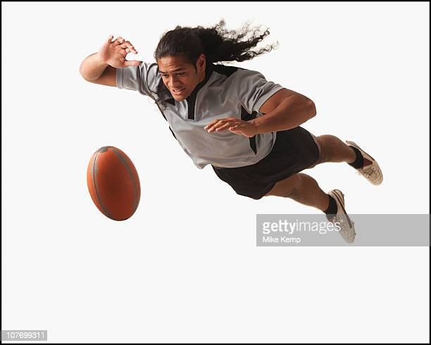 Male rugby player diving for ball