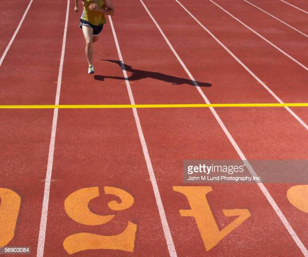 male runner approaching finish line - participant stock pictures, royalty-free photos & images