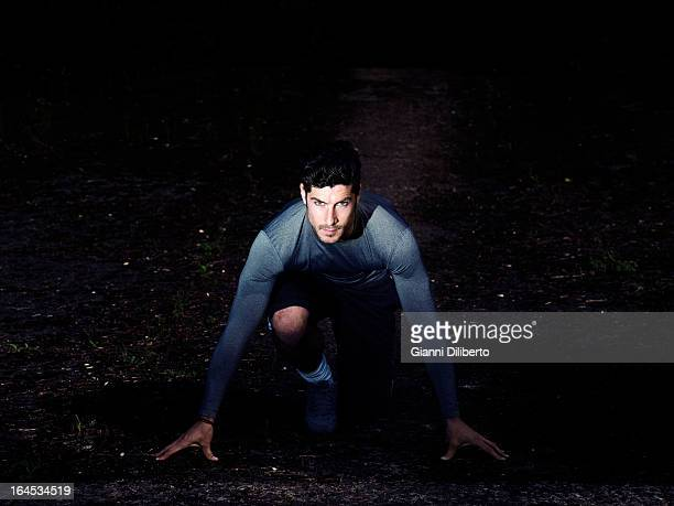 male runner athlete practising start