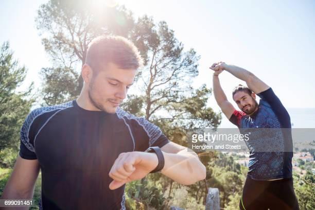 Male runner checking smartwatch in park, Split, Dalmatia, Croatia