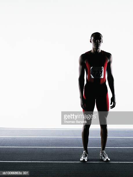 male runner standing on track, portrait - 陸上選手 ストックフォトと画像