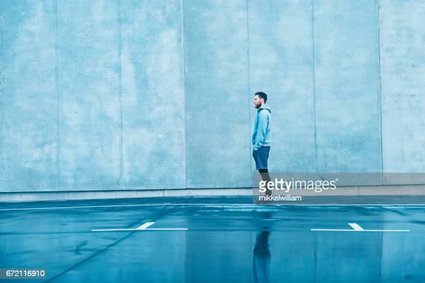 Male runner stands still before a run