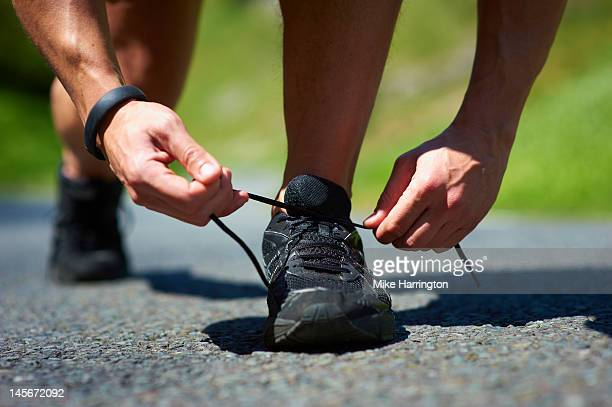Male Runner Tying Shoe Lace