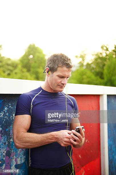 male runner with music - matthew hale stock pictures, royalty-free photos & images