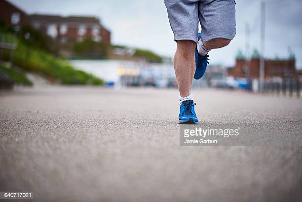 A male running in a urban environment
