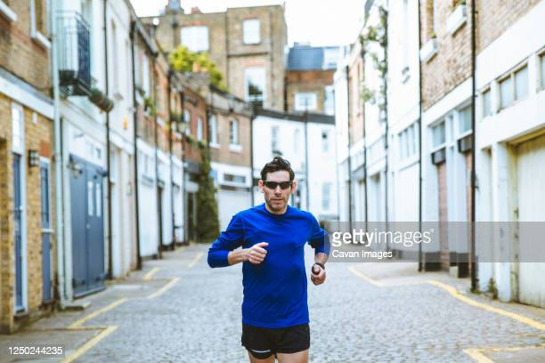 male running in the city - jogging stock pictures, royalty-free photos & images