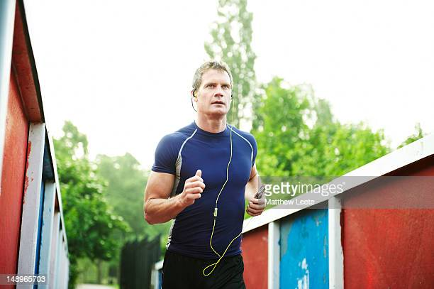 male running with music - matthew hale stock pictures, royalty-free photos & images