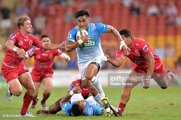 Male Sa'u of the Blues breaks through the defence during the round four Super Rugby match between the Reds and the Blues at Suncorp Stadium on March...