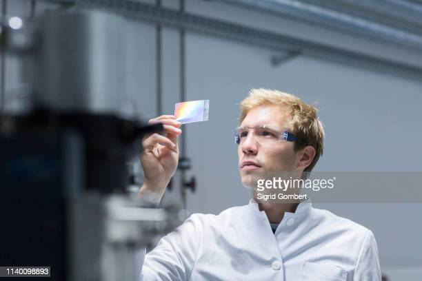 male scientist analysing microscope slide in laboratory - place of research stock pictures, royalty-free photos & images