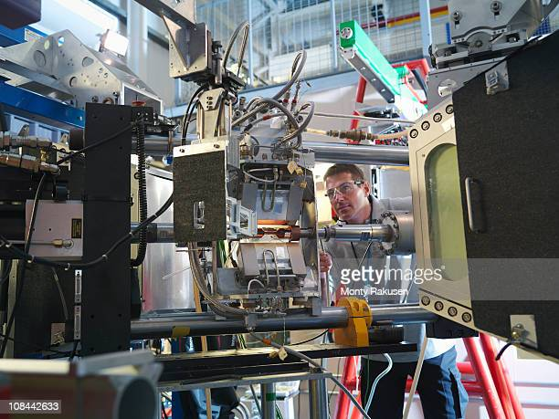 Male scientist inspects particle accelerator target