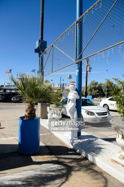 a male sculpture at roadside in baker town, california state, usa - state stock pictures, royalty-free photos & images