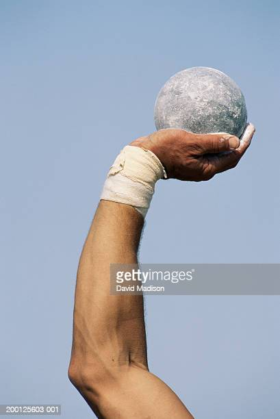 male shot putter holding shot, close-up of arm - shot put stock pictures, royalty-free photos & images
