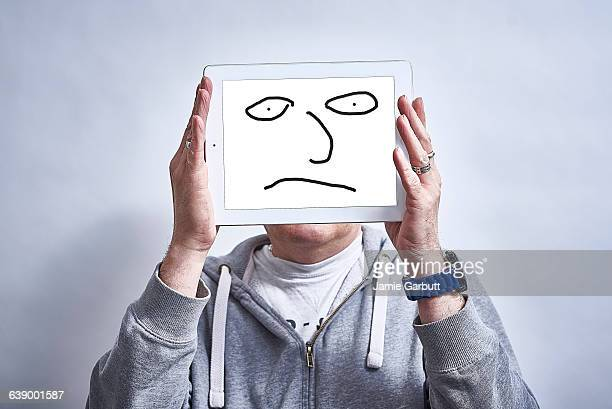 A male showing his feelings drawn on a tablet