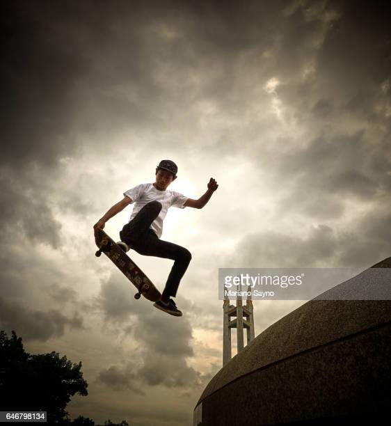 A male skateboarder catches some air