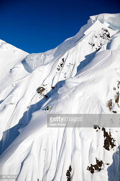 A male skier skis a big first descent in Haines, Alaska.
