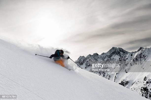 Male skier turning off piste