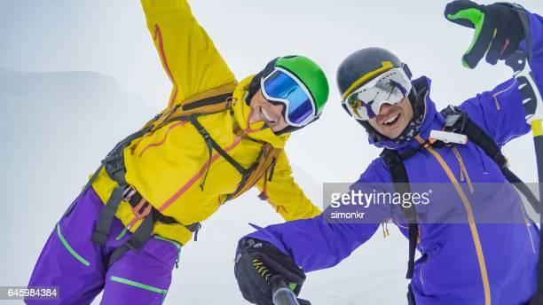 Male skiers enjoying
