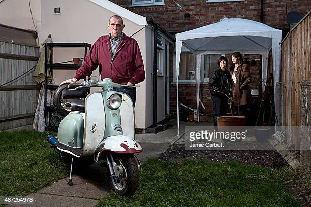 male skinhead with scooter and family - skinhead stock pictures, royalty-free photos & images