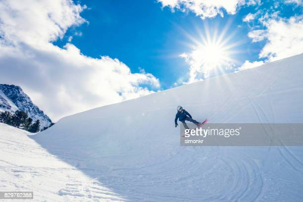 male snowboarder in half pipe - half pipe stock pictures, royalty-free photos & images
