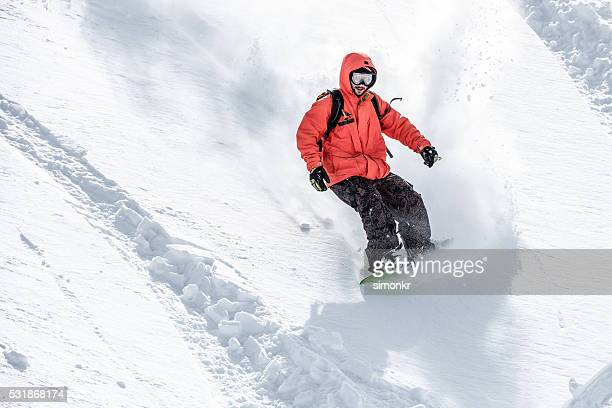 Male snowboarder in snow