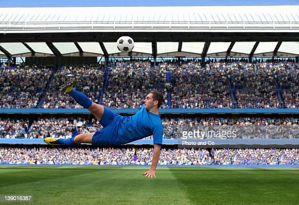 male soccer ball player kicking ball - sportwedstrijd stockfoto's en -beelden