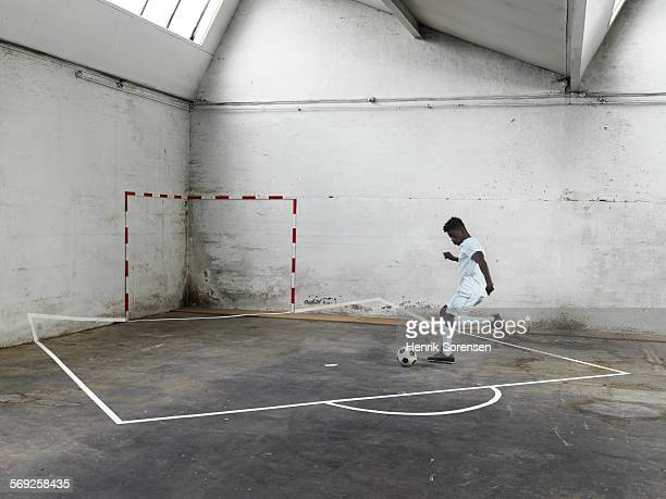 Male soccer player penalty kick