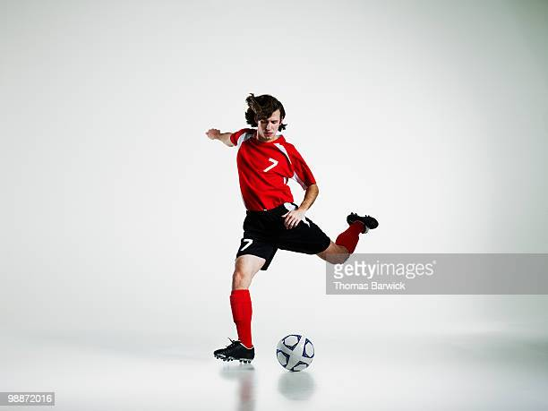 Male soccer player preparing to kick soccer ball