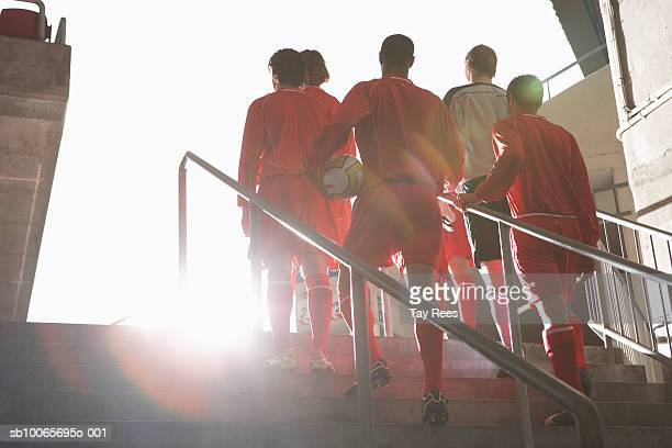 male soccer team entering stadium - football team stock pictures, royalty-free photos & images