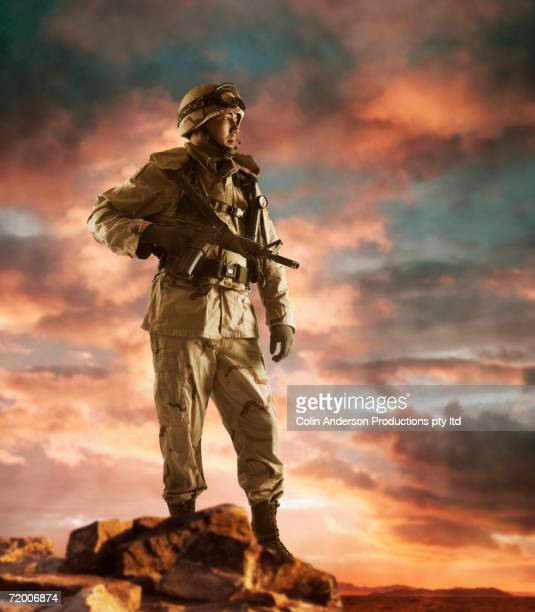 male soldier holding gun - army soldier stock pictures, royalty-free photos & images