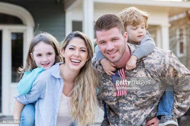 Male soldier is reunited with his family