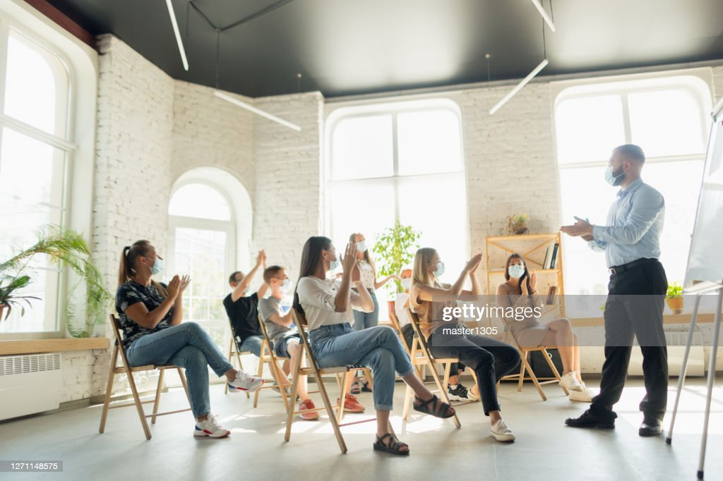 Male speaker giving presentation in hall at university workshop. Audience or conference hall : Stock Photo