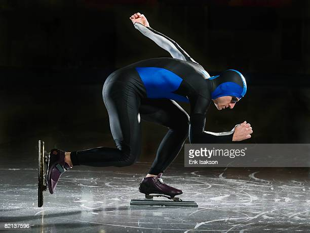 Male speed skater on ice