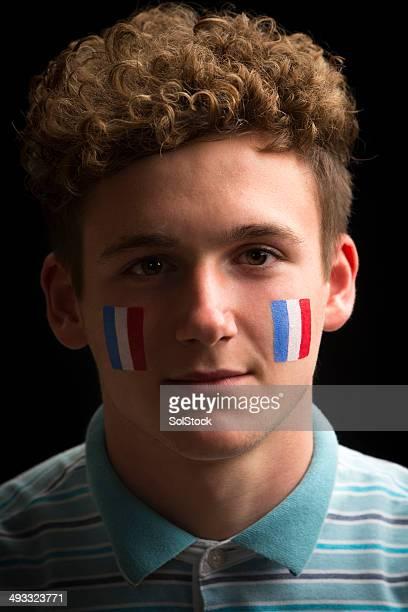 homme fan de sport avec drapeau de peinture sur visage - french football photos et images de collection