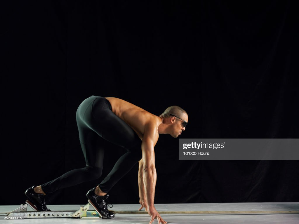 Male Sprinter in Starting Position : Stock Photo