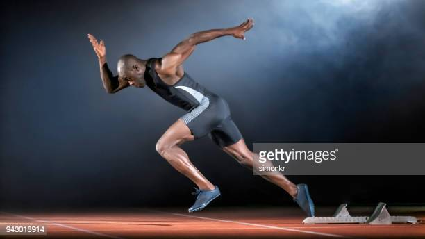 male sprinter running - sprinting stock pictures, royalty-free photos & images
