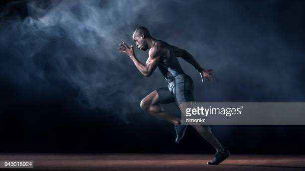 male sprinter running - athlete stock pictures, royalty-free photos & images