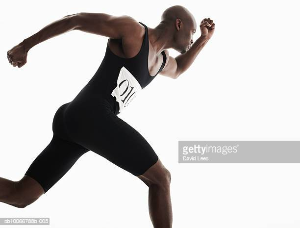 male sprinter running, studio shot - 男子トラック競技 ストックフォトと画像