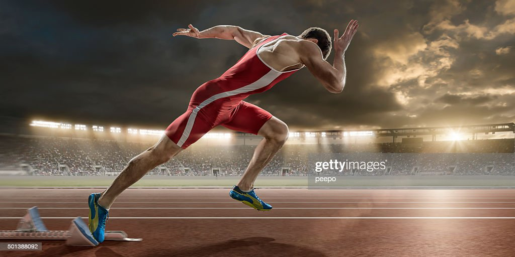 male sprinter sprint starts from blocks in athletics