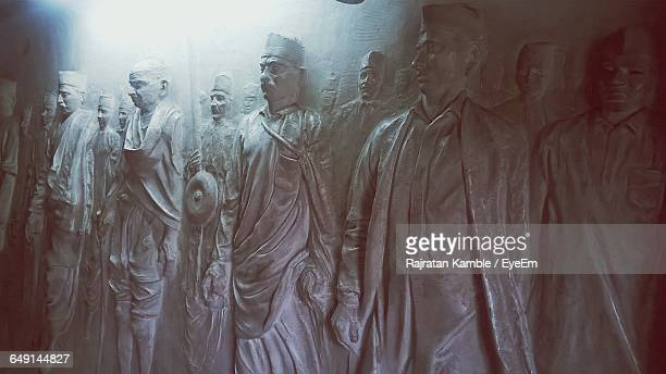 Male Statues Against Wall