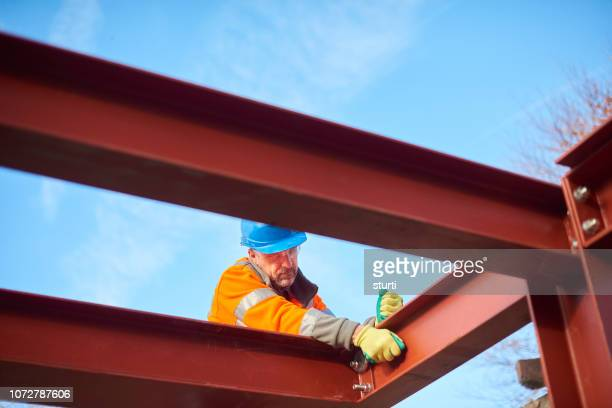 male steel erector - steel stock pictures, royalty-free photos & images