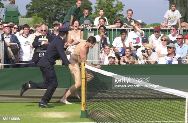 A male streaker is chased by a security guard on Court 14 at Wimbledon during a break in the doubles match between Anna Kournikova and Natasha...