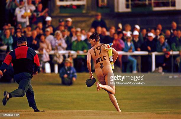 A male streaker with a bag of toy golf clubs on the 18th green during the British Open Golf Championship held at St Andrews Scotland circa July 1995